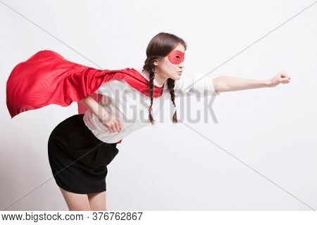 Young Asian woman pretending to be a superhero against white background