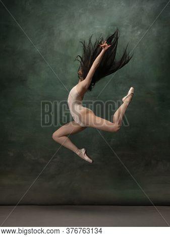 Coming On. Graceful Classic Ballerina Dancing On Dark Studio Background. Pastel Bodysuit. The Grace,