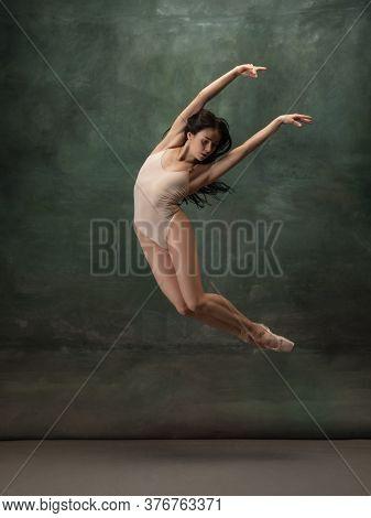 Artwork. Graceful Classic Ballerina Dancing On Dark Studio Background. Pastel Bodysuit. The Grace, A