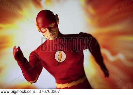 JULY 12 2020  - The Flash action figure from DC Comics in motion - speed force - Mego Corp action figure