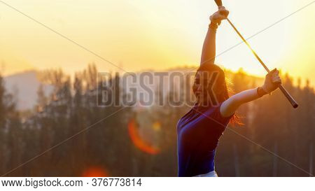 Golfer Woman Cheerful Happy And Relax With A Golf In The Golf Club In The Sunny And Evening Sunset T