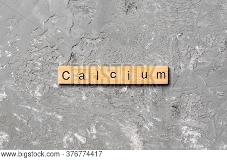 Calcium Word Written On Wood Block. Calcium Text On Cement Table For Your Desing, Concept