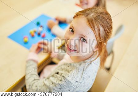 Smiling girl in preschool or elementary school at a game