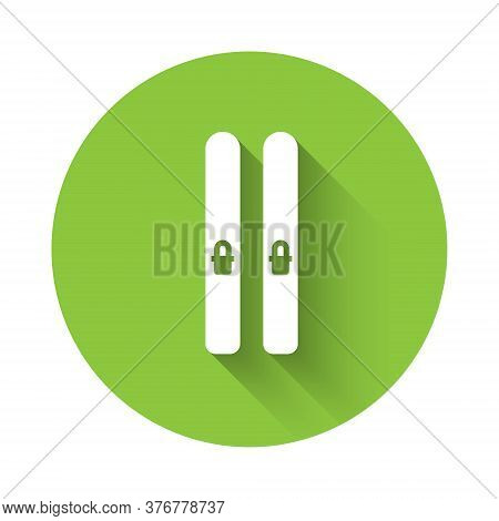 White Ski And Sticks Icon Isolated With Long Shadow. Extreme Sport. Skiing Equipment. Winter Sports