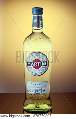 Martini Bianco. A Bottle Of Vermouth Martini Close-up Logo On A Colored Background. Martini Is A Bra