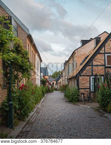 A Cosy Cobblestone Street With Half-timbered Houses In The Old Parts Of The Medieval University City