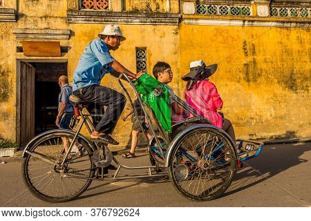 Hoi An, Vietnam - January 10th 2015: A Tour Through The Ancient Old Town In Late Afternoon, By Cyclo