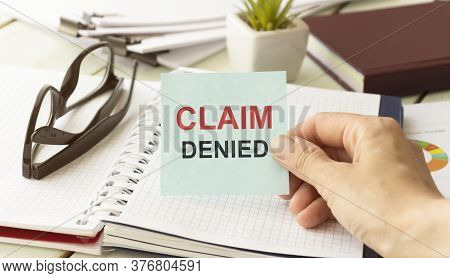 Businessman Putting A Card With Text Claim Denied In The Pocket