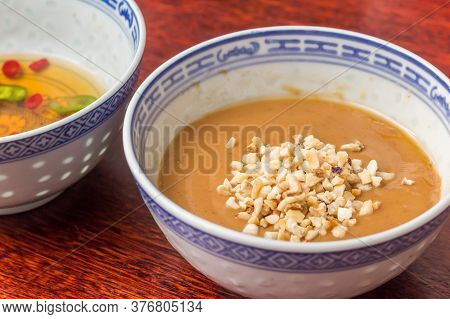 Traditional Indonesian Peanut Sauce In A Traditional Bowl