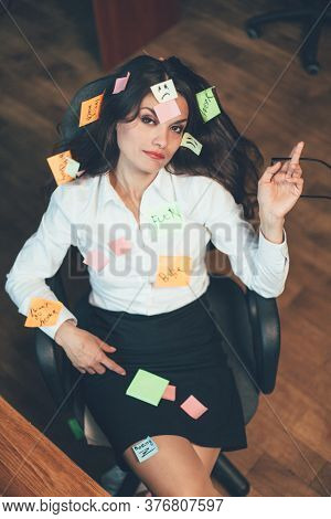 Overworking Or Tired Businesswoman With Pasted Note Stickies Sitting In Office Armchair Looking Up.