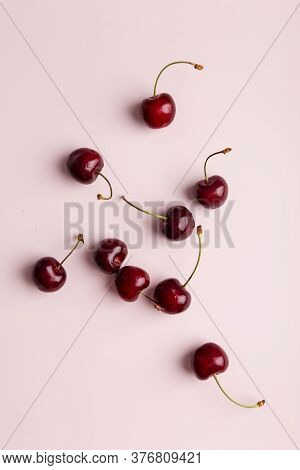 Sweet Cherry At Minimal Pink Background. Group Of Berries At Soft Solid Background. Concept Of Healt