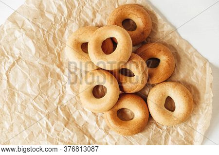 Drying Or Mini Round Bagels On Kraft Paper Background. Copy, Empty Space For Text