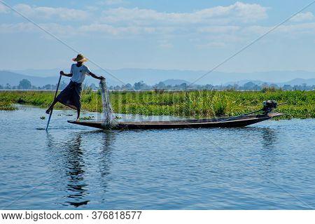 Inle, Myanmar - January 27, Myanmar Inle Lake Burmese Fisherman On Boat Catching Fish.