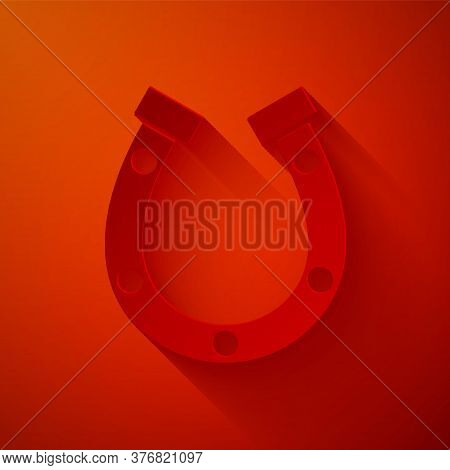 Paper Cut Horseshoe Icon Isolated On Red Background. Paper Art Style. Vector