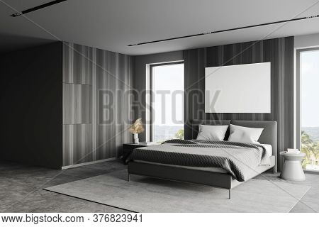 Corner Of Stylish Master Bedroom With Gray And Wooden Walls, Concrete Floor, Comfortable King Size B