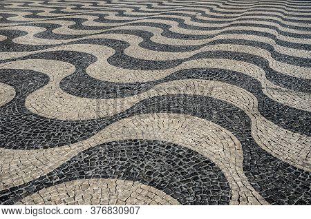 Typical Portuguese Cobblestone Hand-made Mosaic Pavement In Rossio Square (or Pedro Iv Square), Lisb