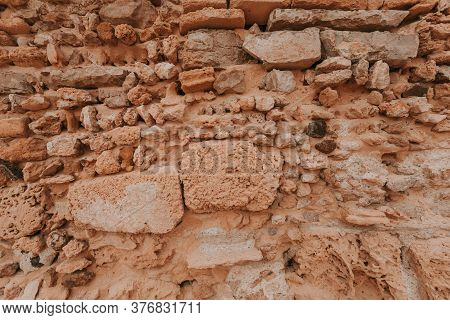 Stone Wall Texture/background,historical Old Ancient Stone,preserved To Our Time, Stones Are Laid Ev