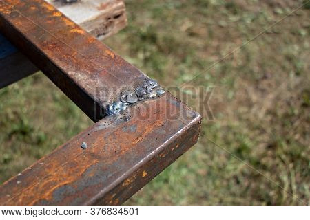 Rusty Metal Pipe With Welded Seam With Copy Space. Seam From Welding. Concept Of Welding