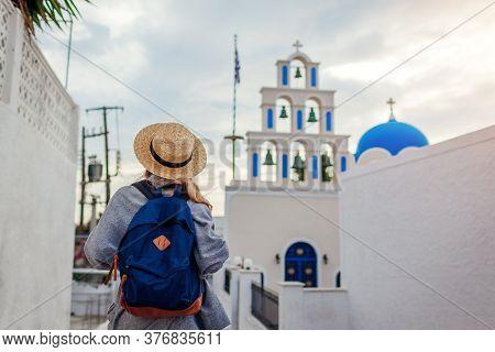 Santorini Tourist With Backpack Walking By Church In Akrotiri On Santorini. Tourism, Traveling, Summ