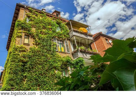 An Old House In Stuttgart,which Is Covered With Ivy