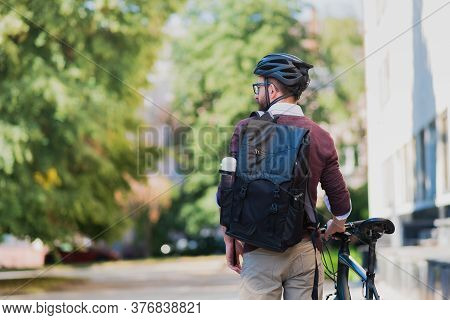 Male Commuter Or Messenger With A Bike In Urban Background. Safe Cycling In The City, Going To Work