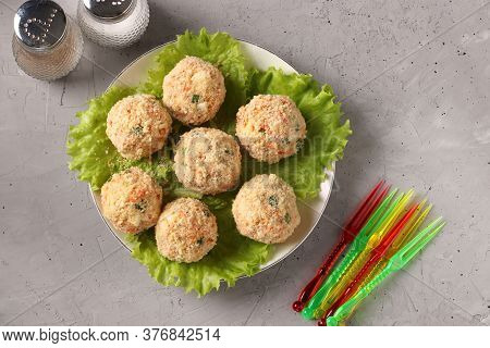 Snack Balls With Chicken, Carrots, Cheese And Green Onions In Cracker Crumbs, Top View On Gray Concr