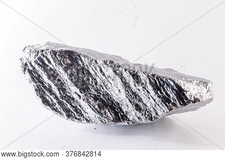 Macro Shot Of Nickel Metal Ore Piece Isolated On A White Background. Closeup Photo Of Surprising Shi