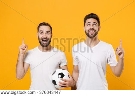 Cheerful Men Guys Friends In White T-shirt Posing Isolated On Yellow Background. Sport Leisure Conce