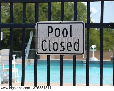A Sign At A Water Slide Pool Is Closed. The Posting Is A Result Of The Covid-19 Pandemic.