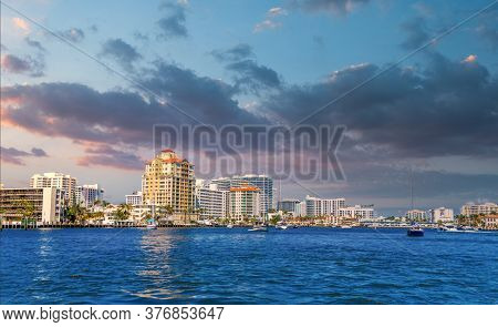 A Blue And White Sailboat In The Intracoastal Waterway In Fort Lauderdale, Florida