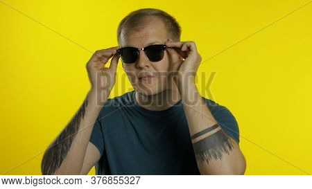 Portrait Of Young Caucasian Man 30s Posing In Green T-shirt Isolated On Yellow Background In Studio.