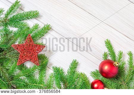 Christmas Or New Year Decorations Background: Tree Branches And Wooden Red Christmas Toys In The For