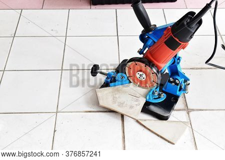 Start To Cut A New Tile Again  By Angle Grinder And Circular Saw Blade That Set Up On Angle Grinder