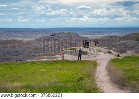 Scenic, South Dakota - June 22, 2020: Tourists Enjoy The View At A Roadside Viewpoint In Badlands Na