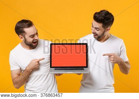 Excited Young Men Guys Friends In White T-shirts Isolated On Yellow Orange Background. People Lifest