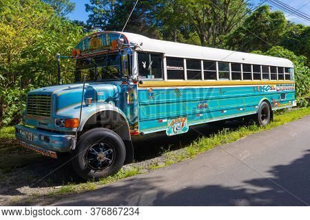 Costa Rica July 14 An Old Colorful And Decorated School Bus Is Parked During The Lockdown Period Of