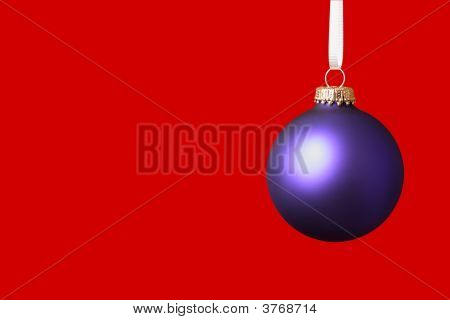 Purple Christmas Ornament On Red Background