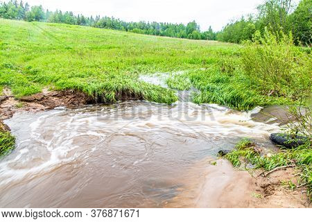 After A Heavy Rain, A Small River In The Field Overflowed Its Banks.