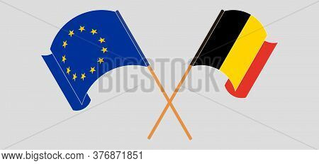 Crossed And Waving Flags Of Belgium And The Eu. Vector Illustration
