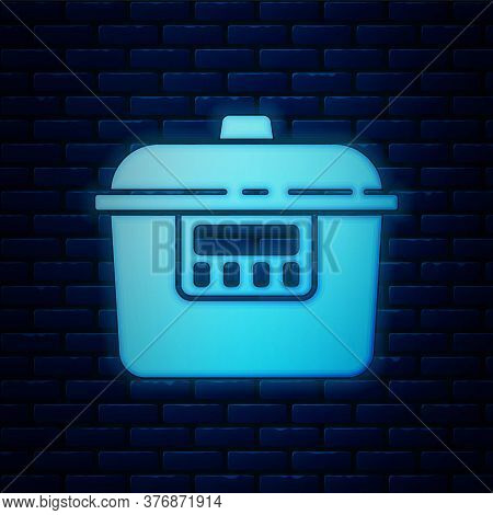 Glowing Neon Slow Cooker Icon Isolated On Brick Wall Background. Electric Pan. Vector