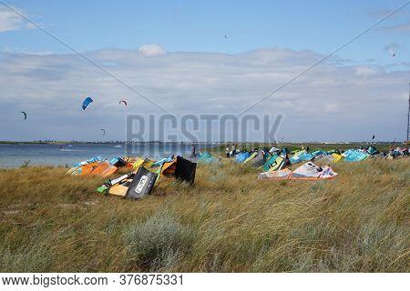 Fedotova kosa, Azov sea, Ukraine. July 10, 2020. Kitesurfing in a firth of Azov sea