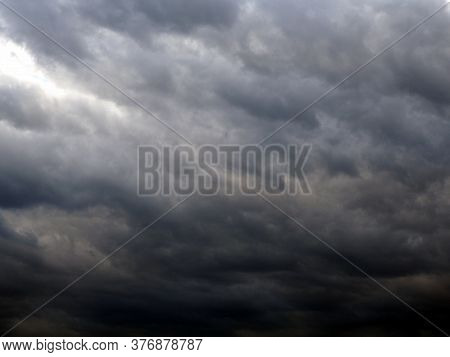 Dark Gray Heavy Clouds In The Sky Before A Thunderstorm. Natural Gloomy Sinister Background. Dramati