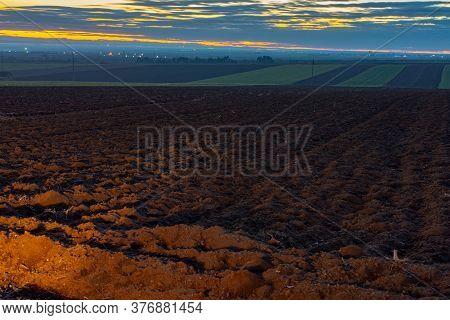 Plowed Farmland Field At Dusk In Vojvodina, Serbia