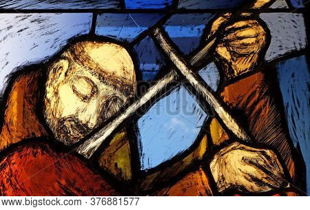 KLEINOSTHEIM, GERMANY - JUNE 08, 2015: Saint Francis of Assisi, detail of stained glass window by Sieger Koder in Franciscan abbey in Kleinostheim, Germany