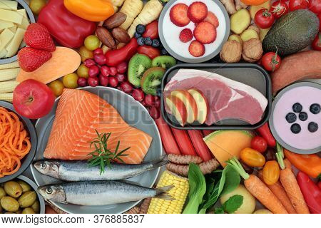 Health food to ease irritable bowel syndrome. Healthy foods high in antioxidants, protein, dietary fiber, vitamins, minerals, smart carbs, omega 3, antioxidants & anthocyanins. Flat lay.