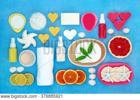 Skin care beauty treatment with citrus fruit, ex foliation, moisturiser & spa cleansing products for a youthful skin. Natural health concept. Flat lay. Top view.