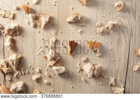 Bread Crumbs On A Wooden Table. Leftover Food