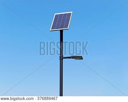 Street Lighting Pole With Photovoltaic Panel Under Blue Sky