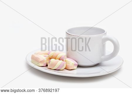 Morning Hot Beverage With Sweet Marshmallows On White Plate. Sweet Souffle And Cup Of Tea On Table.