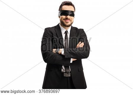 Businessman wearing a blindfold isolated on white background